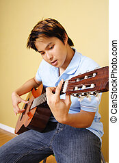 Guitar player - A young man playing guitar