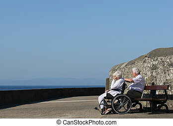 Depression - Disabled elderly woman in a wheelchair with her...