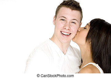 Kiss On The Cheek - A pretty young asian woman kisses her...