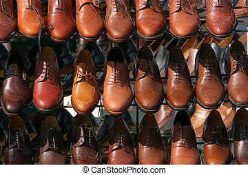Spoilt For Choice - Lines of brown colored mens shoes on a...