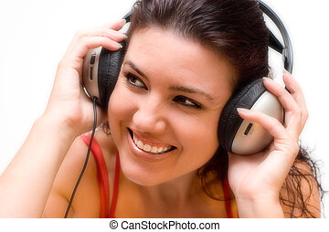 Listening to music - Happy woman with headphones listening...