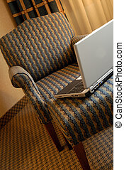 Chair And Computer - Wing Chair With Ottoman And Laptop...