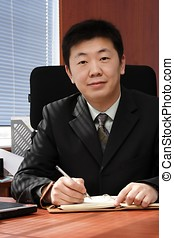Asian Businessman - Asian businessman in the office