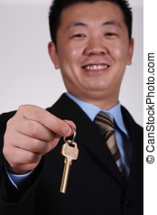 Key To Success! - Asian Businessman with Key