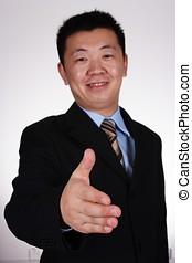 Handshake - Asian businessman ready to handshake.