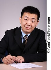 Asian Businessman Writting - Asian businessman writting a...