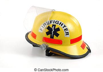 Fire Helmet - A yellow firefighter\\\'s helmet set against a...