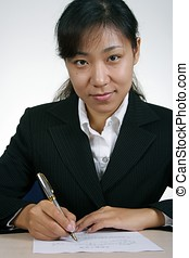 Asian Businesswoman Writting - Asian businesswoman writting...