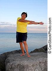 Mature woman exercising outside