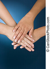 hands show team - woman\\\'s hands show team gesture