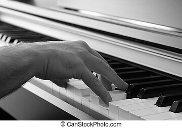 Playing Piano 2 - Closeup on a hand playing the piano
