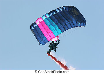 Freedom - Parachutist in a blue boiler suit, with a pink and...