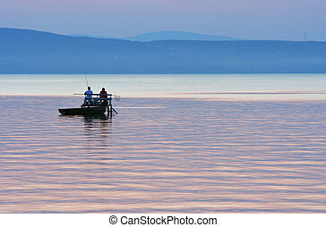 Fishermen after sunset at Lake Balaton, Hungary