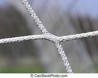 soccer net - Close-up of white soccer net on blurred net...