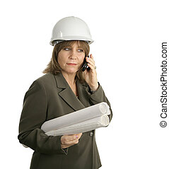Female Engineer Discusses Plans - An attractive female...