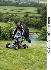 Fun on the Mini Moto Quad Bike - Little boy on a racing a...