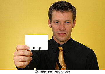 Business Man with Card - Close-up of young Caucasian male...