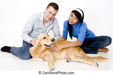 Pet Dog - A young couple with their pet golden retreiver