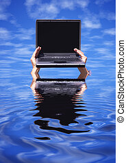 Overwork - laptop with empty screen on the hands and...