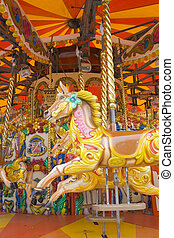 Carousel horses 2 - Garish painted fair ride with horses on...