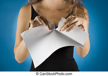 businesswoman tears contract - woman tears white piece of...