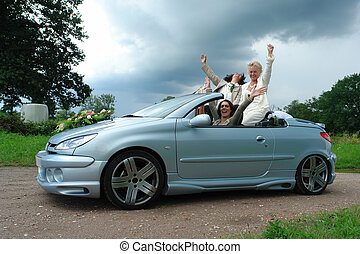 Waiving ladies - Mature lesbian couple posing in car after...