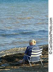 Elderly lady on a seaside