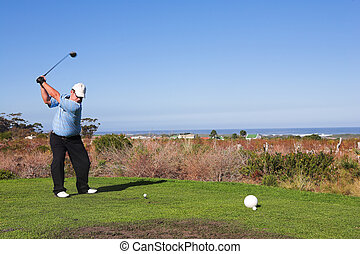 Golfer 58 - A golfer playing golf on a green Movement on...