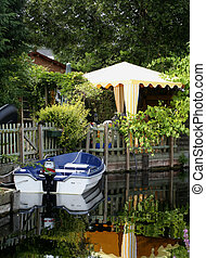 Amsterdam canals - small motorboat in the backyard of a home...