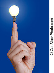 Concept - Small bulb on a finger