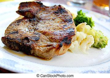 Pork chop dinner - Pork chip dinner with steamed vegetables