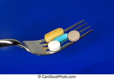 Diet Pills - Fork with Pills - Diet Pills Concept