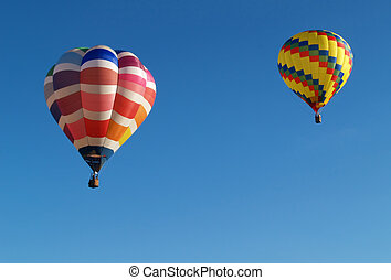 two hot air balloons - two colorful hot air balloons in...
