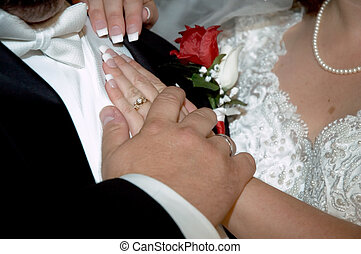 Our wedding day - a bride and groom\\\'s wedding hands with...
