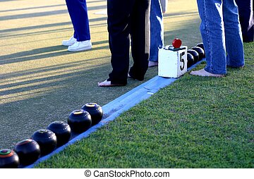 Barefoot Lawn Bowls - People barefoot lawn bowling with...