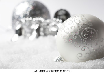 Silver christmas bauble - Christmas bauble lying in fake...