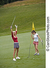 Golf - Women in their early 20s playing golf