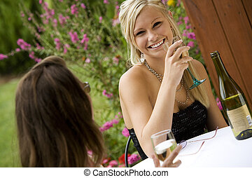 Woman - Young women relaxing with a glass of wine in an...