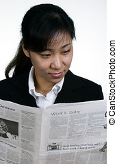 Asian businesswoman reading - An asian businesswoman reading...