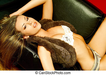 Miss Lingerie - Sexy lingerie female model laying on black...