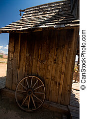 Old rustic shack - Old west style shack and old wagon wheel