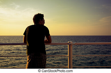open spaces - guy standing on a boat and looking at the sea