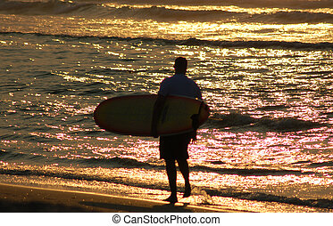 Morning Surfer - Surfer strolling on Wrightville Beach at...