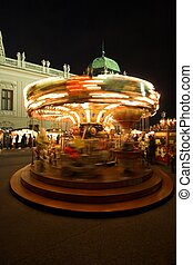 Merry-go-Round on a Christmas Market in Vienna. Motion blur...