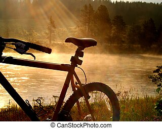 Lakeside Biking - Sun rays display a bike seat.