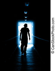 Blue Light - Young Man walking out of the light