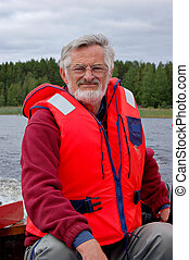 Boat captain - Elderly man driving a speedboat