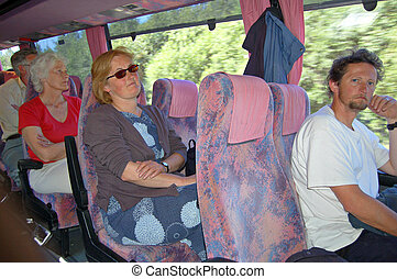 Coach trip - People sitting on a coach