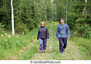Couple walking - Walking in a Finnish forest