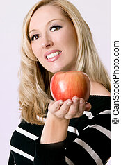 Female holding a fresh red apple